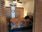Spacious master bedroom with a queen size bed, high ceiling and fan.  Lots of closet space so come and stay awhile.