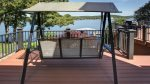 Melt your cares away from this deck swing that overlooks the Lake and private lot.