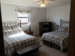 Large third bedroom with 2 full beds and TV for DVD viewing and access to full bath.