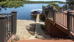 View of the Lake from the deck and steps leading to the propertys private dock.