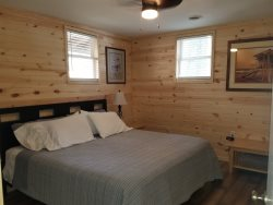 Very Nice Master Bedroom with a Queen Size Bed and TV