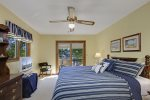 The upstairs master suite is perfect with its flat screen TV and lake views.