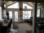 Envision Enjoying This Stunning Lakefront Sun Room with Seating for Five
