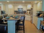 An Absolutely Beautiful Kitchen With Granite Countertops and Breakfast Bar for 4
