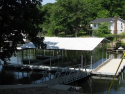 Huge Dock with One Boat Slip, Great Sun Deck and Covered Patio Seating.