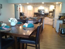 Plenty of Room in the Dining Room to Entertain Plus Having Access to Breakfast Bar Seating