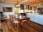 Dining and Kitchen Areas with Upscale Appliances and Furniture