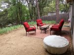 Back patio with furniture and fire pit