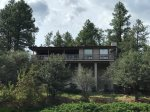 Sweet Retreat Perched on Hillside Nestled in the Tall Pines