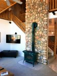 Big Roku TV, Gas Fireplace and Beautiful River Rock Chimney