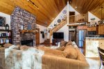 Greatroom with Vaulted Ceiling, Rock Fireplace and Kitchen/Dining Areas