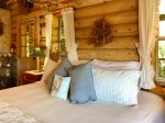 King Bed with Log Post Veiled Canopy