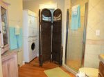 Hall Bathroom has Tiled Shower and and Washer/Dryer