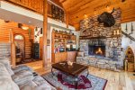 Huge Rock Fireplace in Living Room with Vaulted Ceiling