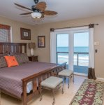 Go right to the beach from the master bedroom`s sliding glass doors