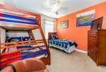 Twin over full bunk with additional twin bed sports themed room