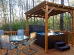 Covered 4 Person hot tub and outdoor dining on side deck
