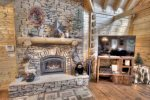 Large stone gas fire place in main living area