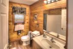 King Bedroom with door leading to screened porch and hot tub