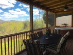 Screened in porch with charcoal and gas grill