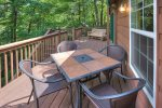 Outside dining table for 4 on upper deck