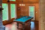 Open living space with pool table