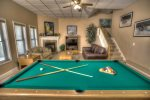 View of downstairs living area from pool table