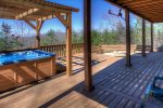 The lower back deck is amazing with arbor covered hot tub and fire pit