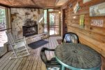 Relax on the covered porch with rockers and swing