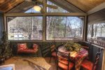 Screened master porch is great for morning coffee or quiet times