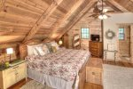 Master loft with mountain laurel railings and wooded views