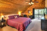 Lower level game room with pool table and pub table for 4