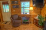 Renovation includes a walk-in shower with natural stone tile