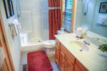 Master bath has step in shower