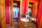 Master bathroom with spa robes for the hot tub