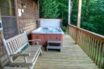 Covered lower deck with hot tub