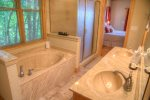 Spa Tub in Master Bath: Just steps away from the master bedroom, this spa tub is perfect after a day of hiking Mt. Yonah or adventuring in Helen