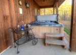 Hot Tub on the covered porch opens to picnic area
