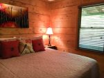 Hot Tub is under the covered porch - perfect for sprinkles or rainy days
