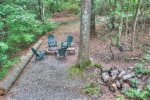 Walk outside the lower level to the fire pit on side yard