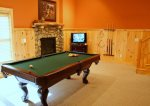 Pool Table, Rock Fire Place, and TV on Lower Level