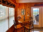Outdoor furniture and seating on main level screened porch