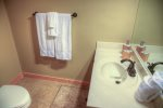 Beautiful Log Bed in Upper Bedroom, along with Flat Screen TV on Chest