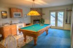 Kitchenette, Living/Dining Area with Fireplace and Pool Tabls adjoins Bedrooms 7 and 8 on Lower Level