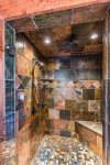 Big Creek Cabin - Stone Tile Shower