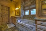 Reel Creek Lodge - Private Bathroom w/ Garden Tub and Walk-In Stone Shower