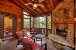 Reel Creek Lodge -  Covered Outdoor Fireplace w/ Plush Seating Options