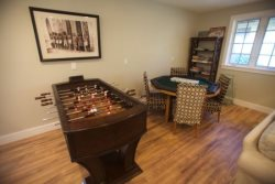 Game room with foosball and poker table
