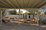 Covered carport- side of house