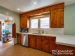 Knotty Pine cabinetry & swing doors